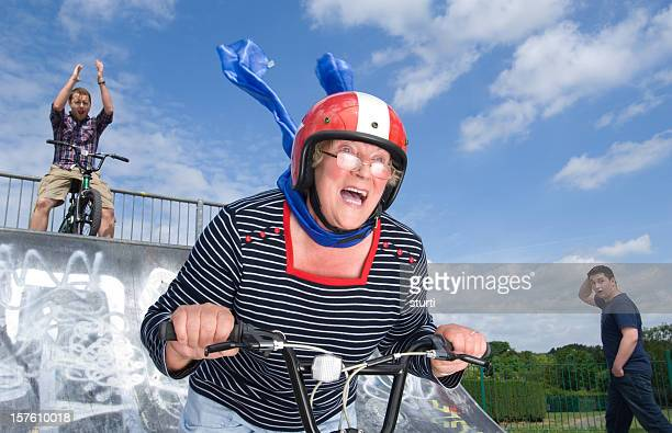 bmx granny - stunt person stock photos and pictures