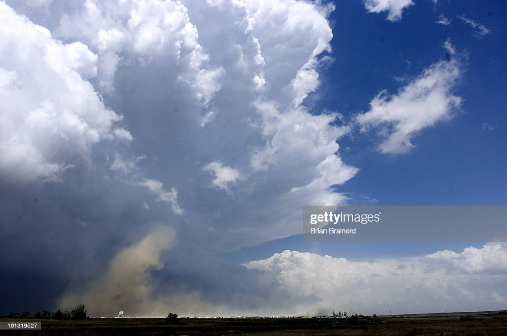 bncd22weather_bb_2 -- A dust tornado sweeps the prarie north of
