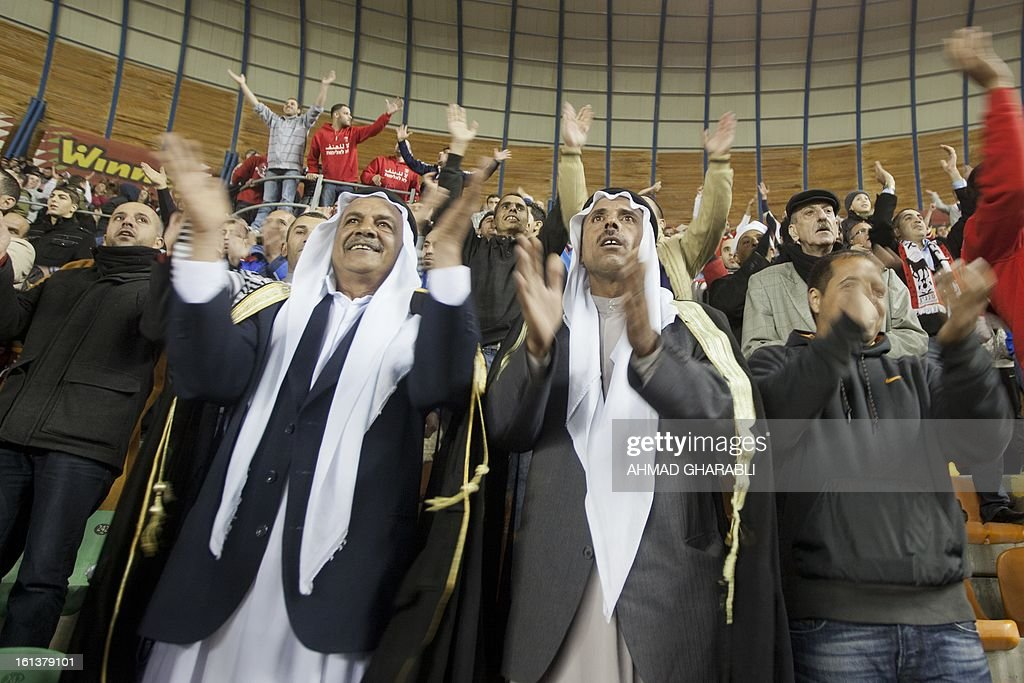 Bnei Sakhnin's supporters chant slogans during an Israeli championship football match between Beitar Jerusalem and Bnei Sakhnin at the Teddy Kollek Stadium in Jerusalem on February 10, 2013. The Beitar Jerusalem soccer club hosted the Israeli Arab team Bnei Sakhnin in a highly charged atmosphere, only three days after indictments were filed against four Beitar fans over charges relating to racism.