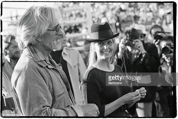 Bo and John Derek walk by photographers in Las Vegas, on April 6, 1987. The actress and her director husband attended the fight between Sugar Ray...