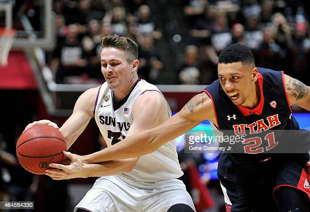Bo Barnes of the Arizona State Sun Devils holds onto the ball as Jordan Loveridge of the Utah Utes tries for the steal in the second half of Utah's...