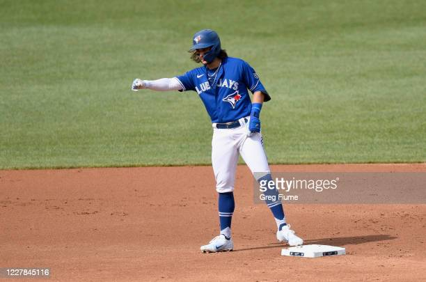 Bo Bichette of the Toronto Blue Jays celebrates after hitting a double in the first inning against the Washington Nationals at Nationals Park on July...