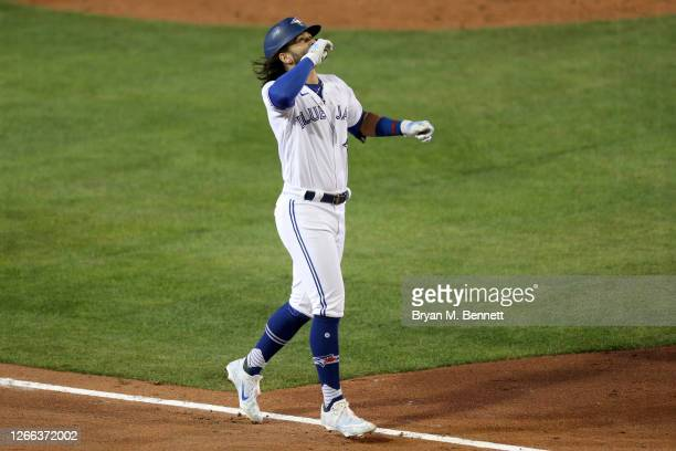 Bo Bichette of the Toronto Blue Jays celebrates after hitting a three run home run during the sixth inning of an MLB game against the Tampa Bay Rays...