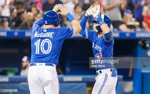 Bo Bichette of the Toronto Blue Jays celebrates his home run with Reese McGuire against the New York Yankees in the fifth inning during their MLB...