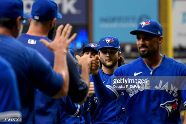 Bo Bichette of the Toronto Blue Jays celebrates with teammates after defeating the Tampa Bay Rays by a score of 3 to 1 at Tropicana Field on July 11,...
