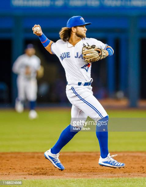 Bo Bichette of the Toronto Blue Jays fields a ball against the Texas Rangers in the third inning during their MLB game at the Rogers Centre on August...