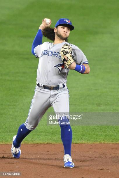Bo Bichette of the Toronto Blue Jays fields a ground ball during a baseball game against the Baltimore Orioles at Oriole Park at Camden Yards on...