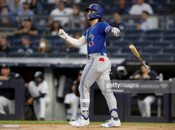Bo Bichette of the Toronto Blue Jays follows through on his first-inning home run against the New York Yankees at Yankee Stadium on September 09,...