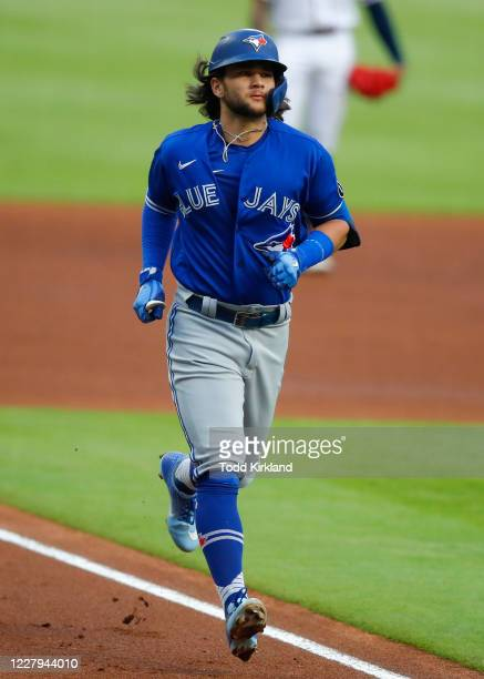 Bo Bichette of the Toronto Blue Jays heads for home on a solo home run in the fourth inning against the Atlanta Braves at Truist Park on August 6,...