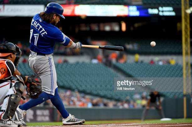 Bo Bichette of the Toronto Blue Jays hits a double during the first inning against the Baltimore Orioles at Oriole Park at Camden Yards on August 3...