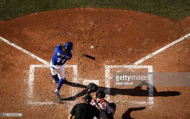 Bo Bichette of the Toronto Blue Jays hits a single against the Houston Astros in the sixth inning during their MLB game at the Rogers Centre on...