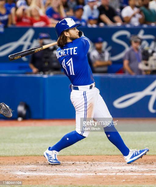 Bo Bichette of the Toronto Blue Jays hits an RBI double against the New York Yankees in the sixth inning during their MLB game at the Rogers Centre...