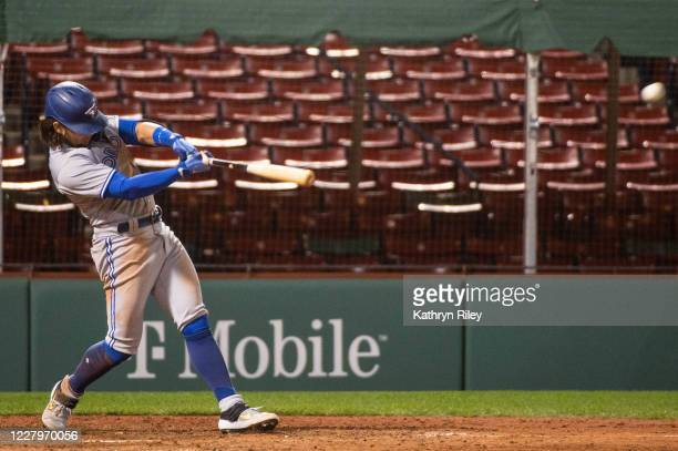 Bo Bichette of the Toronto Blue Jays hits an RBI double to tie the game in the seventh inning against the Boston Red Sox at Fenway Park on August 8,...