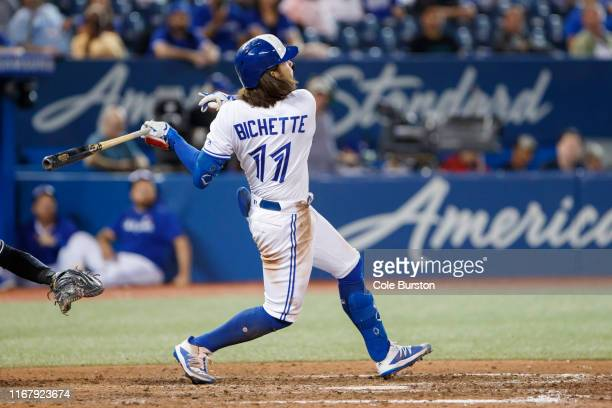 Bo Bichette of the Toronto Blue Jays hits home run to score the winning run in the twelfth inning of their MLB game against the New York Yankees at...