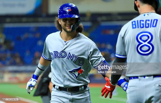 Bo Bichette of the Toronto Blue Jays is congratulated after scoring a run in the first inning during a game against the Tampa Bay Rays at Tropicana...