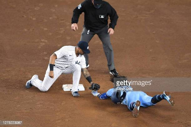 Bo Bichette of the Toronto Blue Jays is out at second by Gleyber Torres of the New York Yankees during the third inning at Yankee Stadium on...