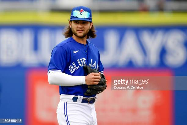 Bo Bichette of the Toronto Blue Jays looks on prior to the game between the Toronto Blue Jays and the Detroit Tigers during a spring training game at...