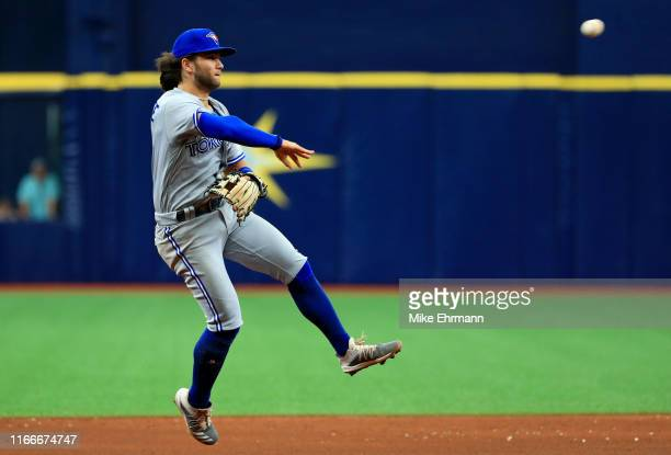 Bo Bichette of the Toronto Blue Jays makes a throw to first in the fifth inning during a game against the Tampa Bay Rays at Tropicana Field on August...