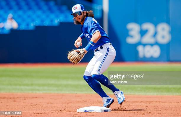 Bo Bichette of the Toronto Blue Jays plays the ball against the Seattle Mariners in the first inning during their MLB game at the Rogers Centre on...