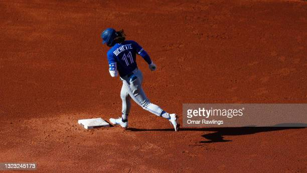 Bo Bichette of the Toronto Blue Jays rounds second base after hitting a solo home run at the top of the fifth inning of the game against the Boston...