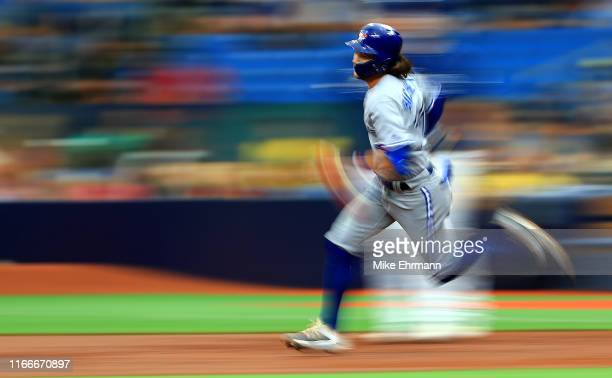 Bo Bichette of the Toronto Blue Jays runs to second in the third inning during a game against the Tampa Bay Rays at Tropicana Field on August 07 2019...