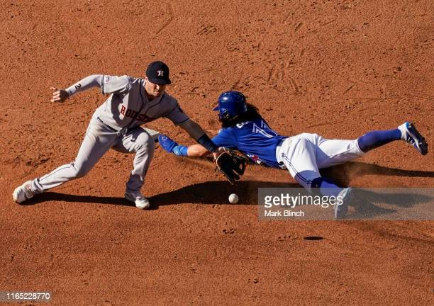 Bo Bichette of the Toronto Blue Jays steals second base against Alex Bregman of the Houston Astros in the sixth inning during their MLB game at the...