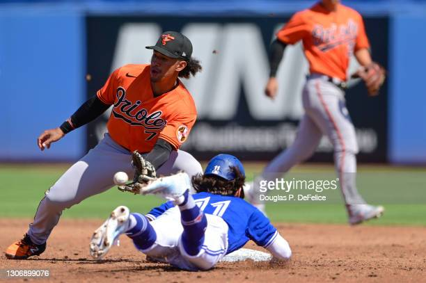 Bo Bichette of the Toronto Blue Jays steals second base safely under the glove of Jahmai Jones of the Baltimore Orioles during the third inning of a...