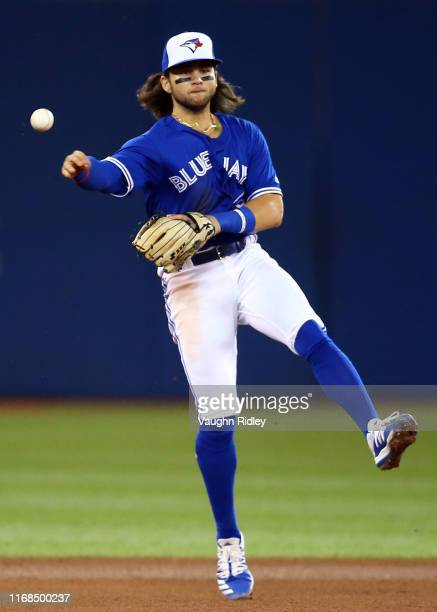 Bo Bichette of the Toronto Blue Jays throws Gleyber Torres of the New York Yankees out in the seventh inning during a MLB game at Rogers Centre on...