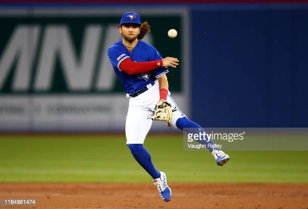 Bo Bichette of the Toronto Blue Jays throws to first base to force Robinson Chirinos of the Houston Astros out in the third inning during a MLB game...