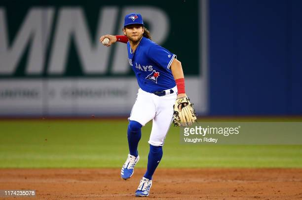 Bo Bichette of the Toronto Blue Jays throws to first base to get Robinson Chirinos of the Houston Astros out in the third inning during a MLB game at...