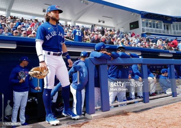 Bo Bichette of the Toronto Blue Jays waits to take the field during the spring training game against the Minnesota Twins at TD Ballpark on February...