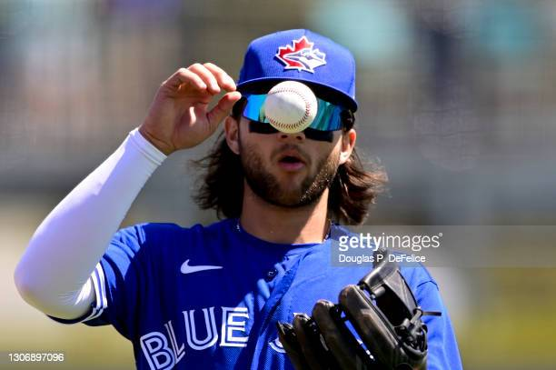 Bo Bichette of the Toronto Blue Jays warms up prior to the game between the Toronto Blue Jays and the Baltimore Orioles during a spring training game...