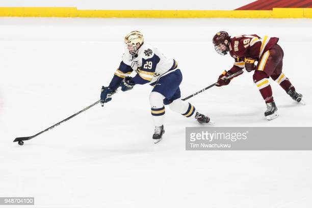 Bo Brauer of the Notre Dame Fighting Irish skates past Justin Richards of the MinnesotaDuluth Bulldogs during the Division I Men's Ice Hockey...
