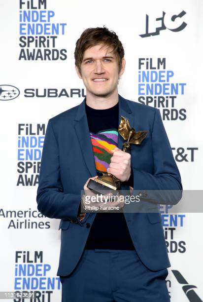 "Bo Burnham poses in the press room with the Best First Screenplay award for the film ""Eighth Grade"" during the 2019 Film Independent Spirit Awards on..."