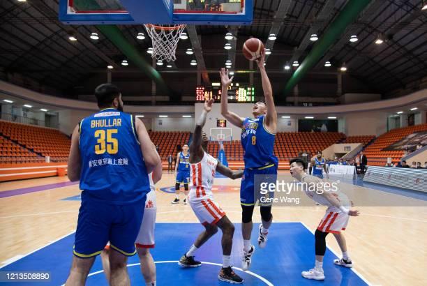 Bo Chen Chou of Yulon Luxgen Dinos made a layup shot during the Super Basketball League closed door match between Pauian Archiland and Yulon Luxgen...