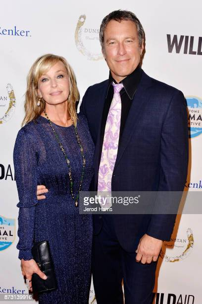 Bo Derek and John Corbett arrive at 'Evening With WildAid' at the Beverly Wilshire Four Seasons Hotel on November 11, 2017 in Beverly Hills,...