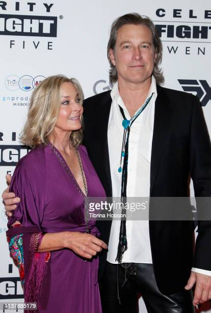 Bo Derek and John Corbett attend Celebrity Fight Night XXV at JW Marriott Phoenix Desert Ridge Resort & Spa on March 23, 2019 in Phoenix, Arizona.