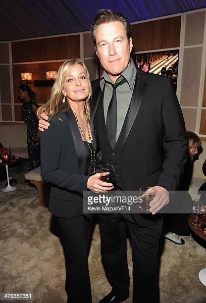 Bo Derek and John Corbett attend the 2014 Vanity Fair Oscar Party Hosted By Graydon Carter on March 2, 2014 in West Hollywood, California.