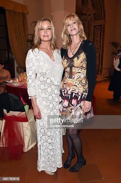 Bo Derek and Melanie Griffith attend the Eva Longoria Foundation Dinner Gala during the 60th Taormina Film Fest at Hotel San Domenico on June 17 2014...