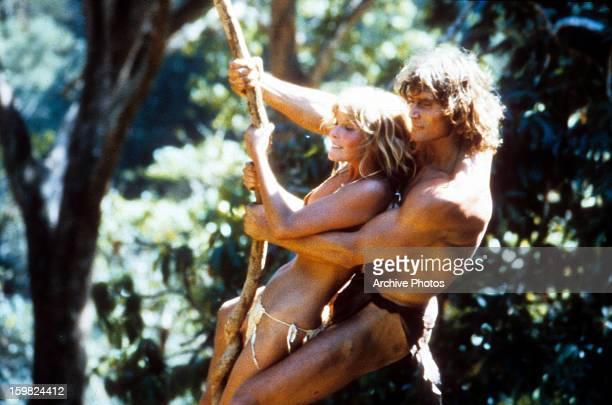 Bo Derek and Miles O'Keeffe swinging on vine in a scene from the film 'Tarzan The Ape Man' 1981