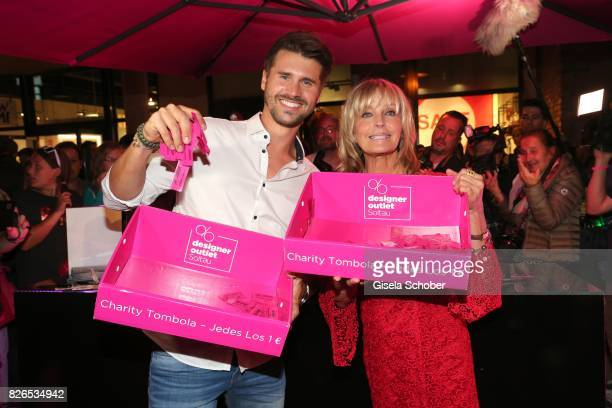 Bo Derek and Thore Schoelermann sell lots during the late night shopping at Designer Outlet Soltau on August 4 2017 in Soltau Germany