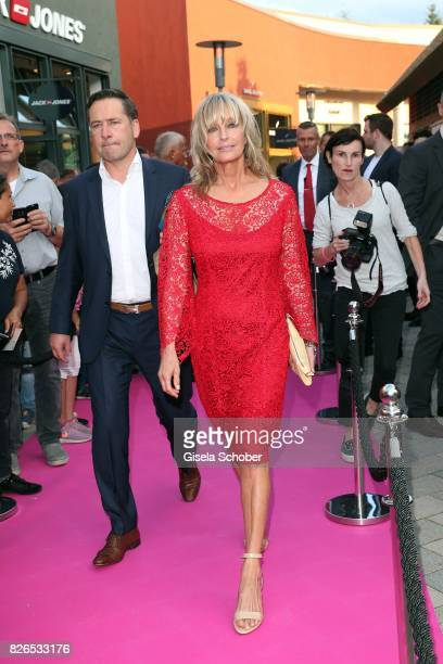 Bo Derek wearing a red dress by Minx during the late night shopping at Designer Outlet Soltau on August 4 2017 in Soltau Germany