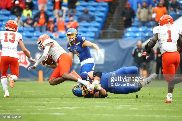 Bo Donald of the South Dakota State Jackrabbits tackles Quentin Brown of the Sam Houston State Bearkats following an interception during the Division...