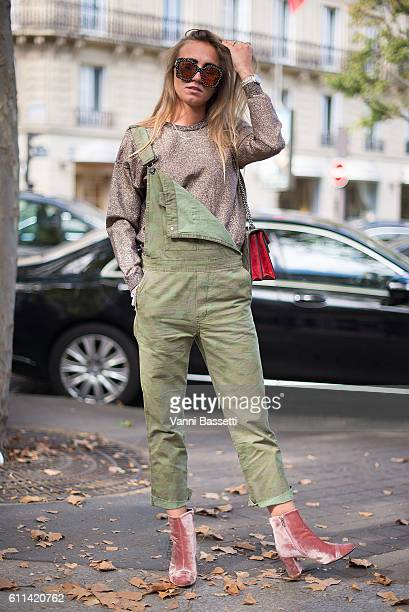 Bo Galle poses wearing a Zara overall Other Stories sweatshirt and Gucci bag after the Balmain show at the Hotel Potocki during Paris Fashion Week...
