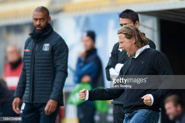 Bo Henriksen head coach of AC Horsens celebrates with a dejected David Nielsen head coach of AGF Aarhus in the background after the Danish Superliga...