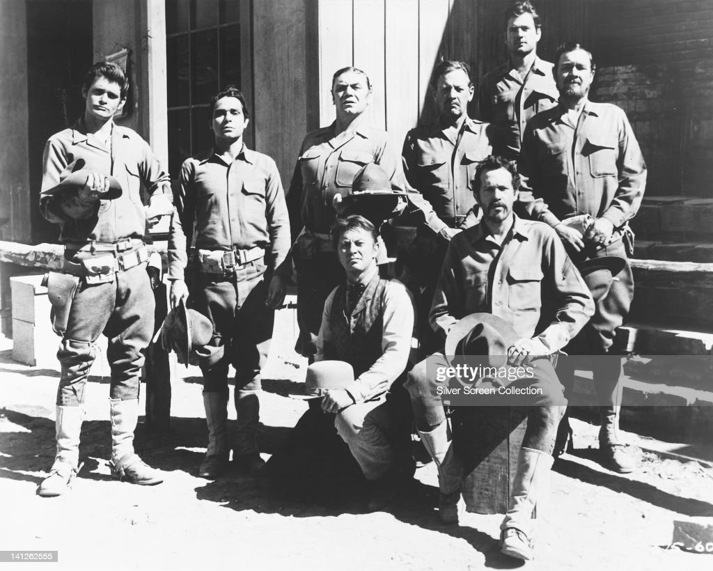 Bo Hopkins, US actor, Jaime Sanchez, Puerto Rican actor, Ernest Borgnine, US actor, William Holden (1918-1981), US actor, Ben Johnson (1918-1996), US actor, and Warren Oates (front right, 1928-1982) pose for a group portrait issued as publicity for the film, 'The Wild Bunch', 1969. The western, directed by Sam Peckinpah (1925-1984), starred Hopkins as 'Clarence 'Crazy' Lee', Oates as 'Lyle Gorch', Johnson as 'Tector Gorch', Holden as 'Pike Bishop', and Borgnine as 'Dutch Engstrom'.