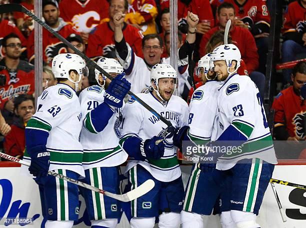 Bo Horvat, Chris Higgins, Brandon McMillan, Christopher Tanev and Alexander Edler of the Vancouver Canucks celebrate McMillian's goal against the...