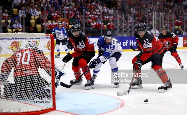 Bo Horvat of Canada and Veli Matti Savinainen of Finland during the 2018 IIHF Ice Hockey World Championship Group B game between Canada and Finland...