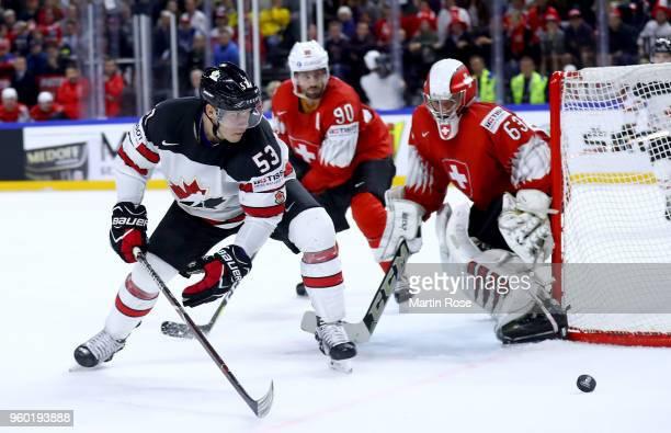 Bo Horvat of Canada fails to score over Leonardo Genoni goaltender of Switzerland during the 2018 IIHF Ice Hockey World Championship Semi Final game...
