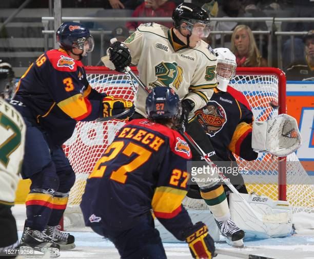 Bo Horvat of the London Knights puts a screen on for teammate Seth Griffith goal in front of Oscar Dansk of the Erie Otters in an OHL game on...